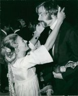Franco Nero dancing with Vanessa Redgrave in a party.