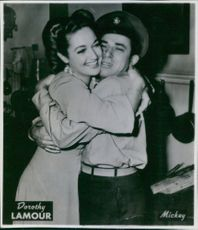Dorothy Lamour hugging a soldier, 1944.