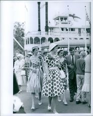 A photo of Princess Margrethe of Denmark (center) Outside Frontierland 1960.