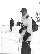 Red Cross on the winter field exercise, to Gosta Virgin, in uniform on skis in the snow