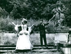 Jean-Claude Brialy holding hand of woman and sculpture. 1961