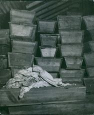 Photo of a pile of coffins.