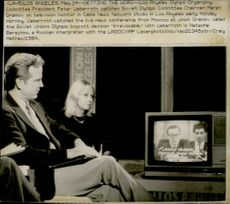 Peter Ueberroth takes part in a news broadcast from the Soviet Union where Marat Gramov announces the Soviet Union's decision to boycott the OS