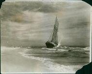 A ship moving on the sea, about to reach at coast.
