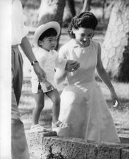 Princess Michiko together with her daughter walking.