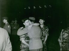 Soldiers embracing each other.
