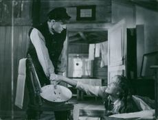 """Ragnar Falck and Eva Dahlbeck in the scene from the movie, """"A Just A Mother""""."""