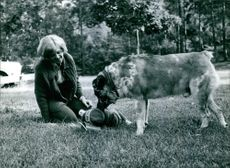 Buster the dog with Eva Johansson and her daughter Fia.