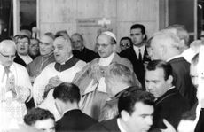 Pope Paul VI standing with joined hands.