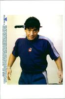 Diego Maradona speaks with a songwriter during a visit to a neurological clinic