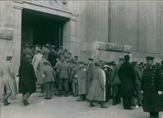 German soldiers gathered and entering in the building.