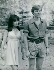 Michael York standing with woman.