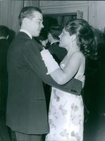 Prince Michel of Orléans dancing with Béatrice.