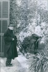 William Maugham wearing a hat in the backyard. 1965.