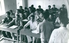 A teacher with his student in a classroom, in Vietnam, August 1965.
