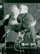 General James Lee Dozier kisses his wife Judith at a press conference after 42 days as hostage of the Red Brigades