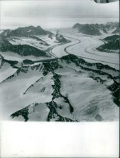 An Aerial view of a Greenland covered with snow.