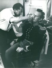 "A man cutting beard of Cecil Antonio ""Tony"" Richardson."