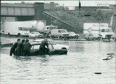 Floods 1966-1989:A stranded motorist in guildford.