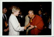 Sharon Stone greets the Dalai Lama under garden party at Harrison Ford and Melissa Mathison