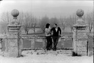 Bernard Buffet standing on a balcony with his wife.