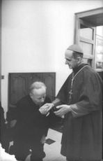 Pope Paul VI with a man receiving his blessings.