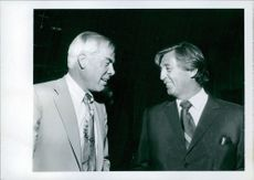 Lee Marvin and Robert Mitchum attending party hosted by Jane and Vernon Scott, 1970.