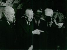 Konrad Hermann Joseph Adenauer with other men.