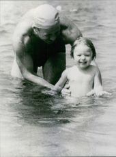 Alexey Leonov swimming with his daughter. 1965.