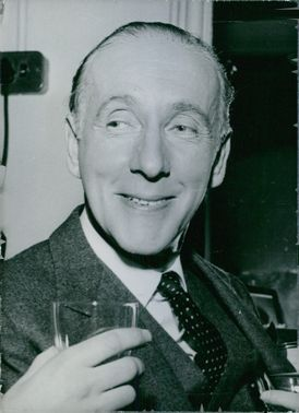 Close-up photo of British actor: Wilfrid Hyde White, smiling.