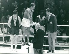 Boxing athletes during awarding ceremony.  Taken - Oct. 1964