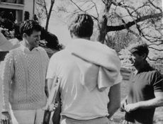 Ted Kennedy talking to man.