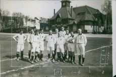 Football team standing together in the ground. 1909