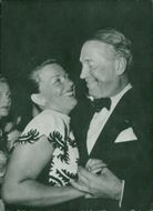 Zita Fiore with Maurice Chevalier is dancing on film ball in Cannes