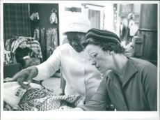 Inkosi Albert John Luthuli's wife browsing for items in a retail shop.  Taken - 16 Dec. 1961