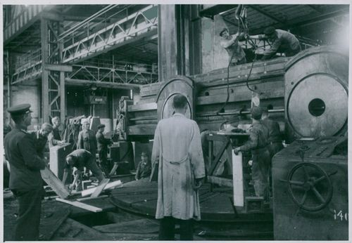 A Russian Officer watches dismantling of the Schiess Defried machine-tool factory near Duesseldorf, 1946.