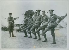 Soldiers standing in position and officer commanding, 1915.