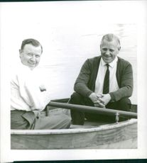 Two men on a rowing boat.