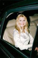 Claudia Schiffer arrives at the unveiling of a wax sculpture depicting her at the Musee Grevin