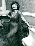 Eartha Kitt in beautiful dress in her hotel room