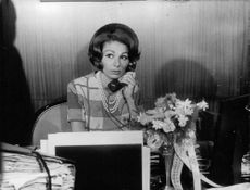 Princess Soraya talking on telephone.