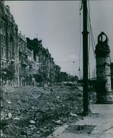 View of destructed building and debris lying in the street of Hungary  1945 Hungary
