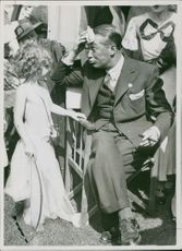 Maurice Auguste Chevalier with child.