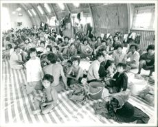 Vietnamese boat people newly arrived in center.