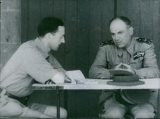 A British officer in Egypt interrogates an Italian general who was one of the first prisoners of war taken in the fighting on the Eastern Front.  - 1940