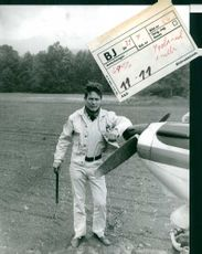 Jacques Charrier standing besides plane.