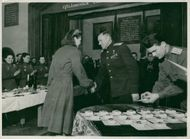 At a celebration evening devoted to International Women's Day on March 8th, Marshal Rokossovsky presents an Order to the girl flyer Anna Dudina.