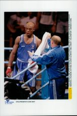 British boxer Fola Okesola with coach Ian Irwin after losing to American Nate Jones during the 1996 Olympic Games