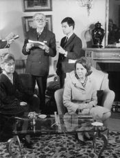 Princess Irene of Netherlands sitting on a chair at the living room with some guests.