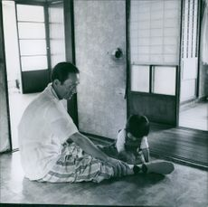 Man playing with child.